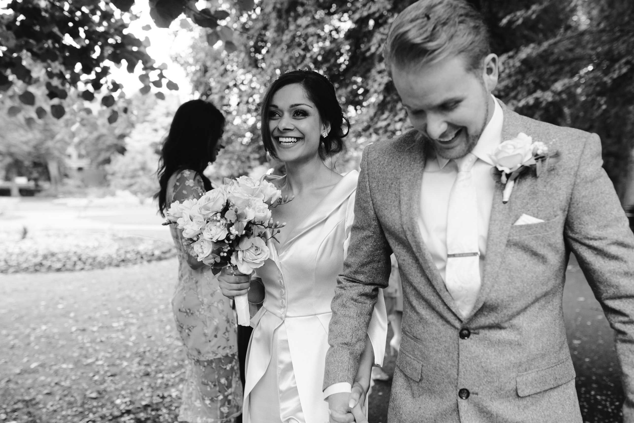 relaxed confetti photo of a happy bride and groom after their lichfield intimate wedding ceremony