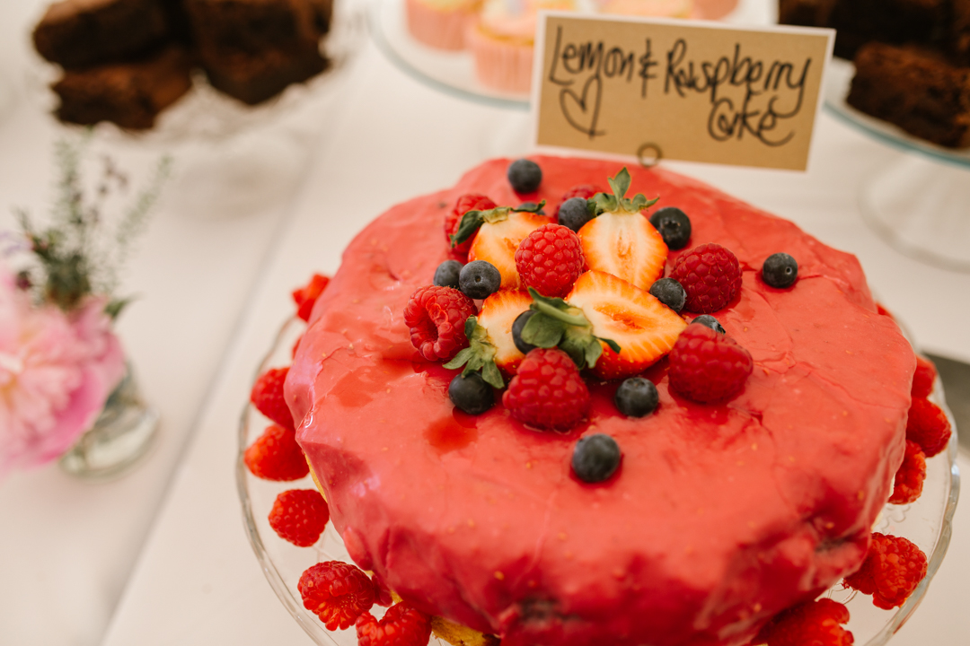 homemade strawberry cake on the dessert table in the marquee at the walled garden