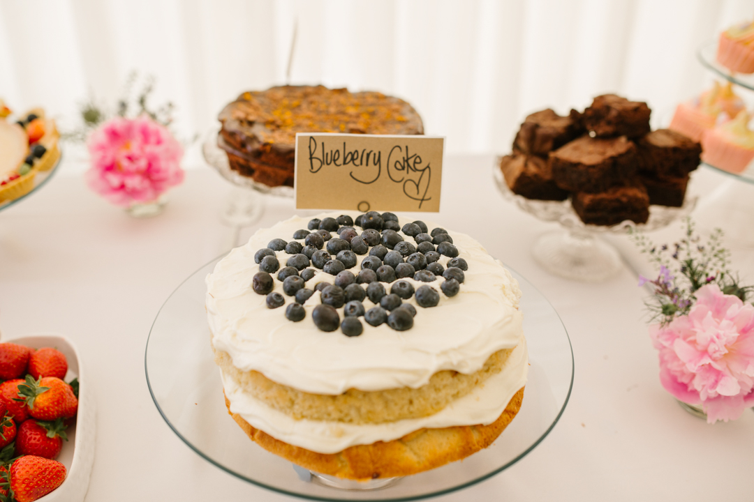 homemade blueberry cake on the dessert table at a wedding in the walled garden beeston fields