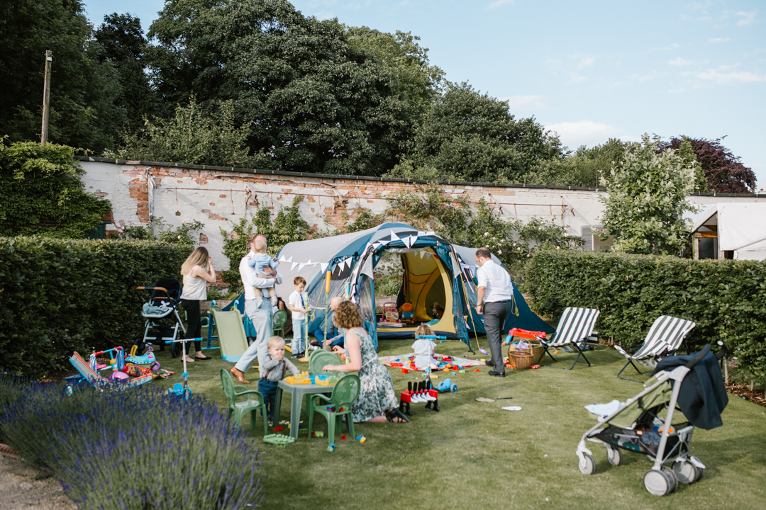 a tent set up for children to play at a summer wedding in nottingham at the walled garden beeston fields
