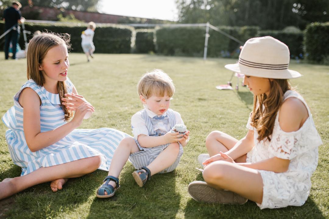 children at a summer wedding having a picnic at the walled garden beeston