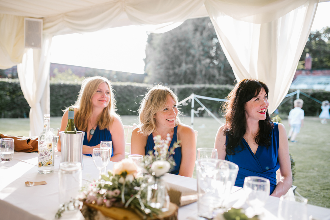 bright natural photo of bridesmaids during the wedding speeches at the walled garden in nottingham