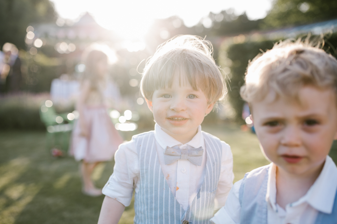 close up photo of children at weddings in the golden hour sunlight