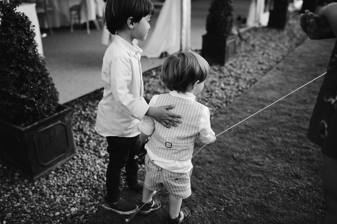 black and white natural photo of children at summer wedding