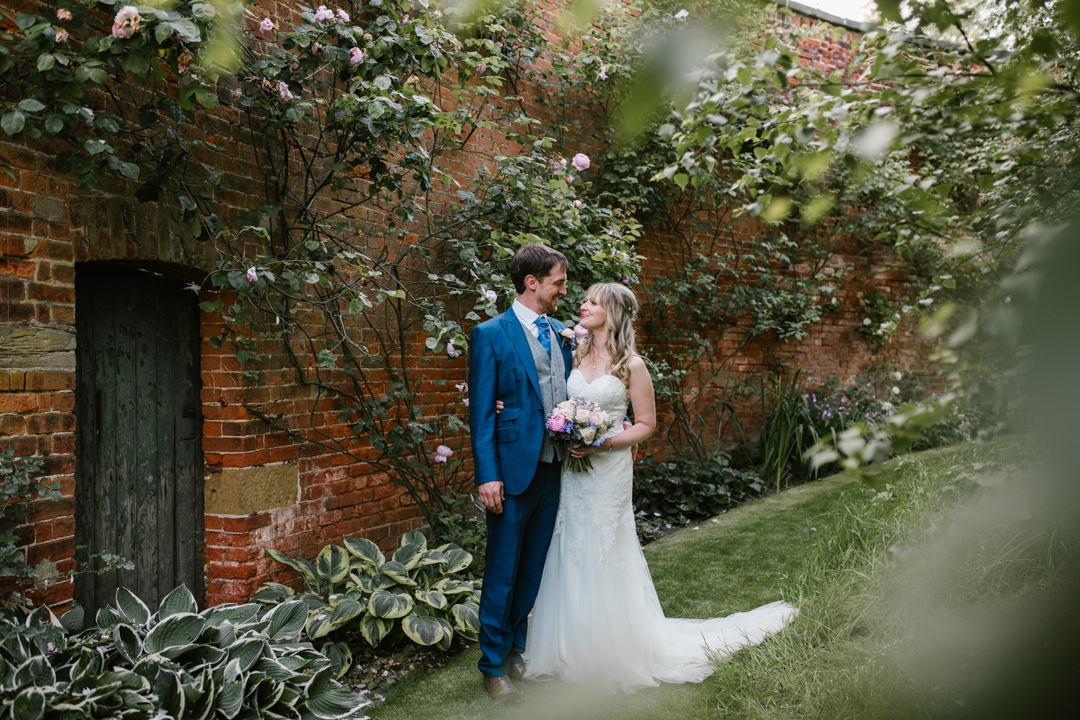 romantic photo of bride and groom at their wedding reception in the walled garden