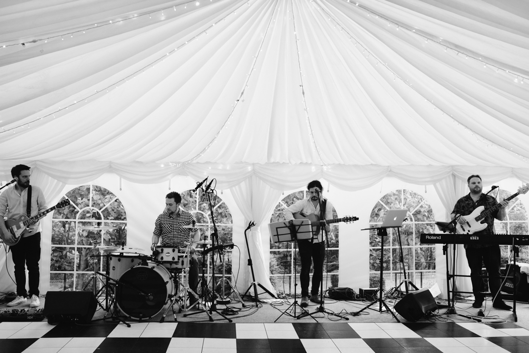 black and white photo of wedding band in a marquee at nottingham wedding