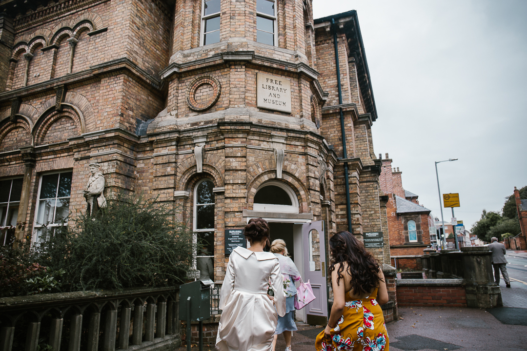Indian bride entering lichfield registry office before intimate wedding ceremony