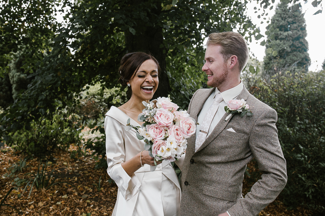 happy natural photo of bride and groom laughing in beacon park - lichfield wedding