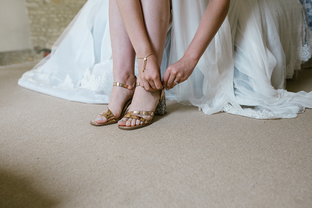 bride as she ties her river island shoes