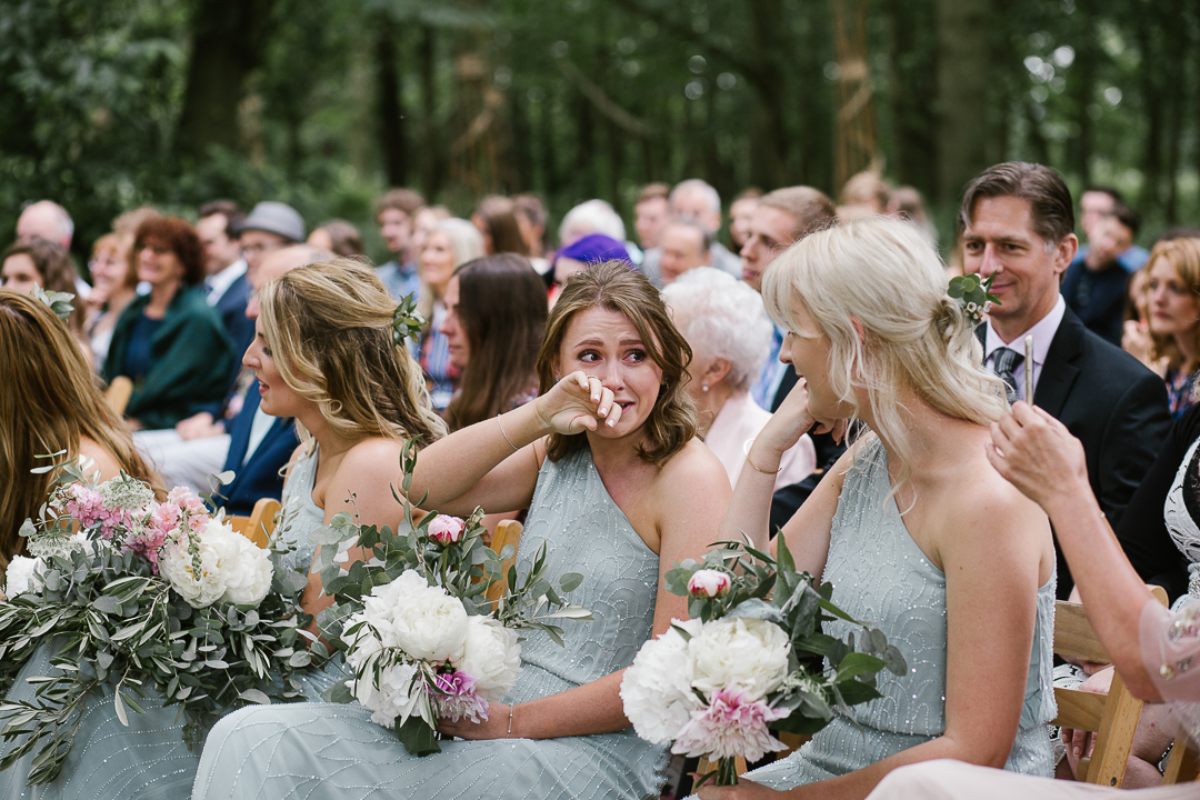 bridesmaid crying during emotional wedding ceremony