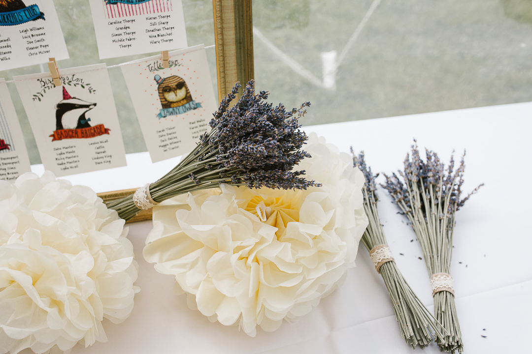 dried lavender and pom pom decorations in a marquee wedding venue