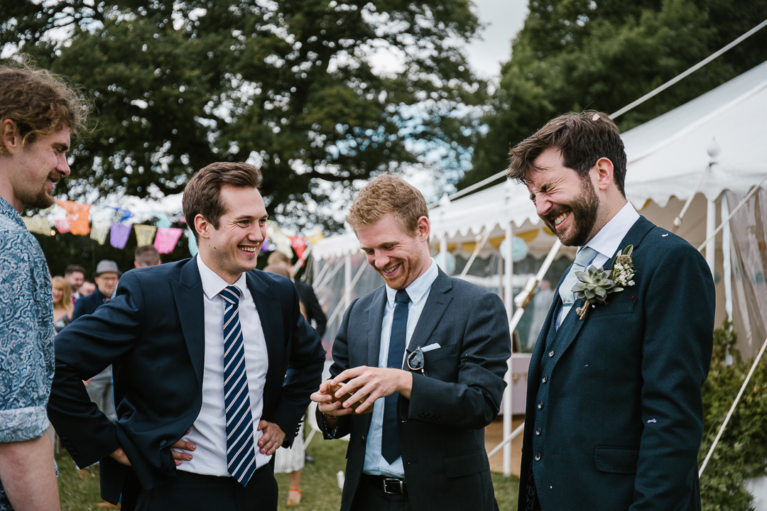 wedding guest throws confetti into the grooms face at his marquee wedding