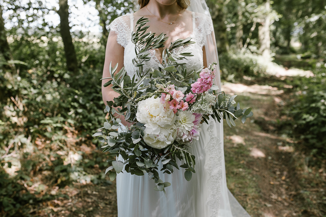 natural photo of wedding bouquet holding wild summer flowers
