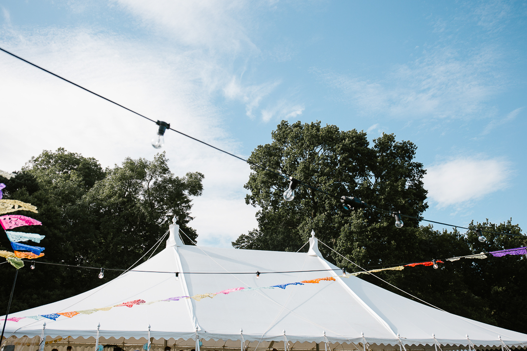 Festoon lights and the top of marquee wedding venue