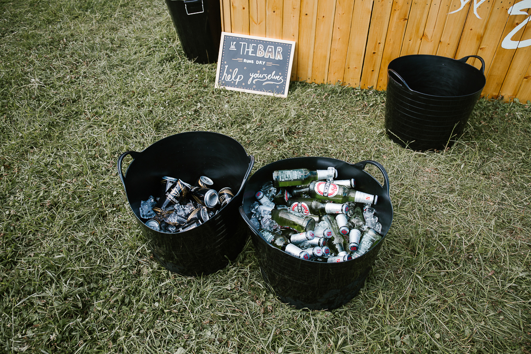 buckets full of beer at a festival wedding in the cotswolds