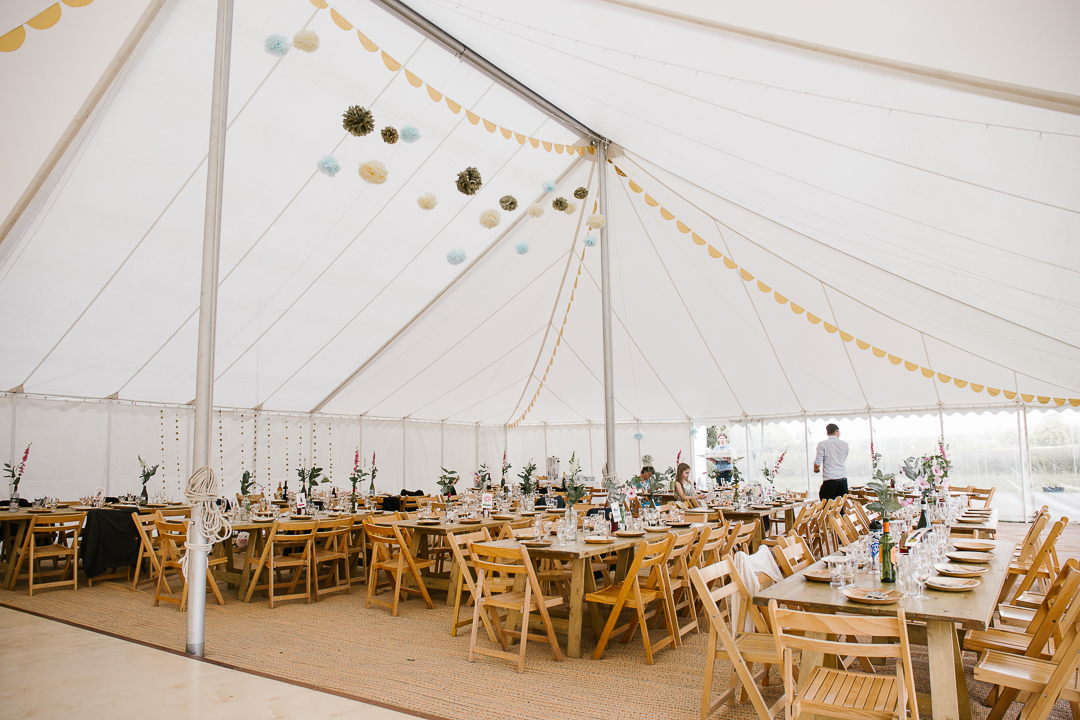 interior of wedding marquee at festival themed wedding in the cotswolds