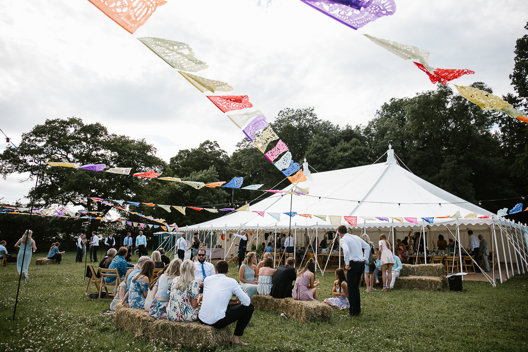 festival themed marquee wedding at wildwood bluebell in the cotswolds