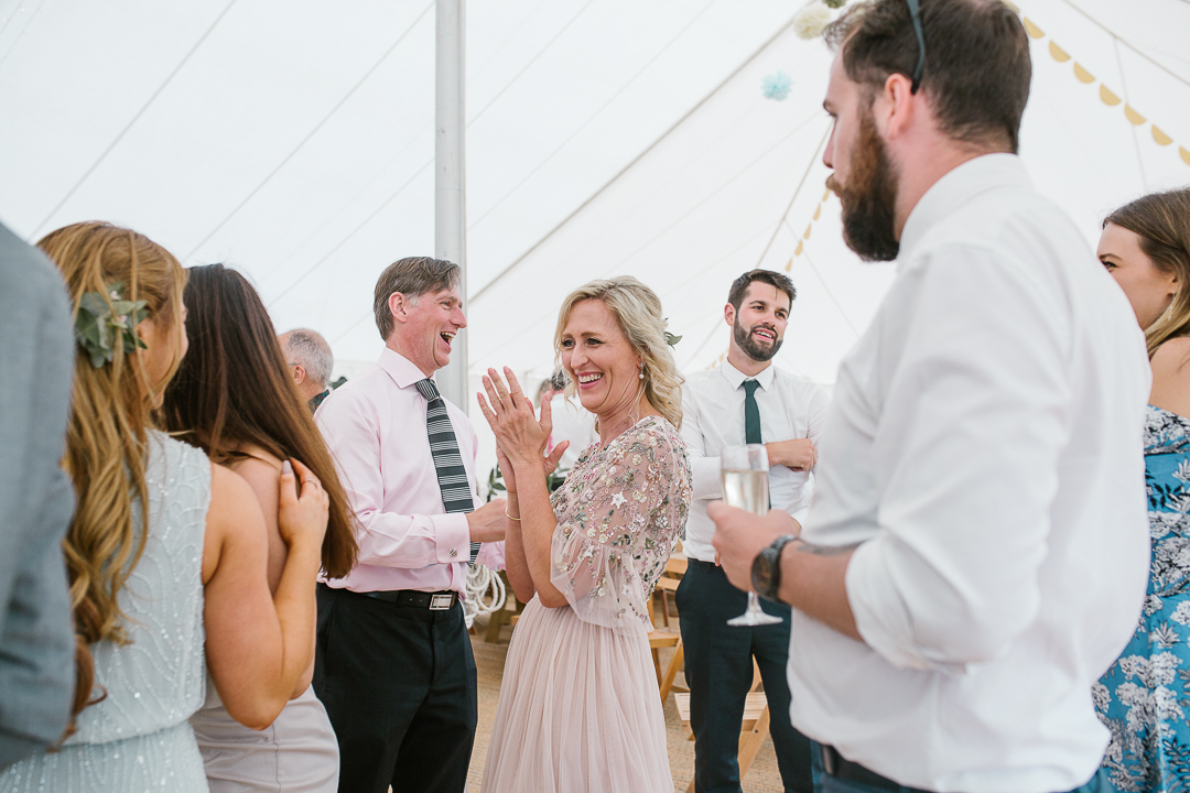 natural photo of the mother of the bride dancing during the live music in the marquee- cotswolds wedding
