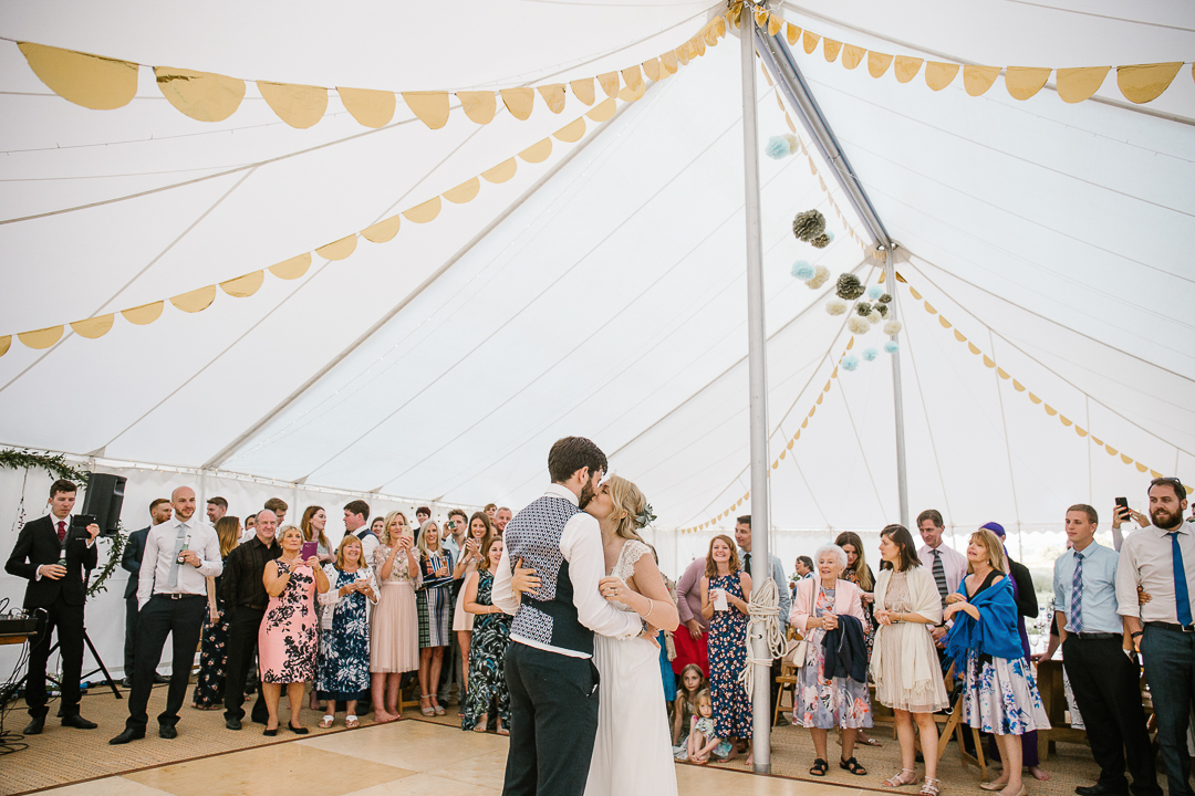 natural photo of bride and groom during their first dance at their festival themed wedding