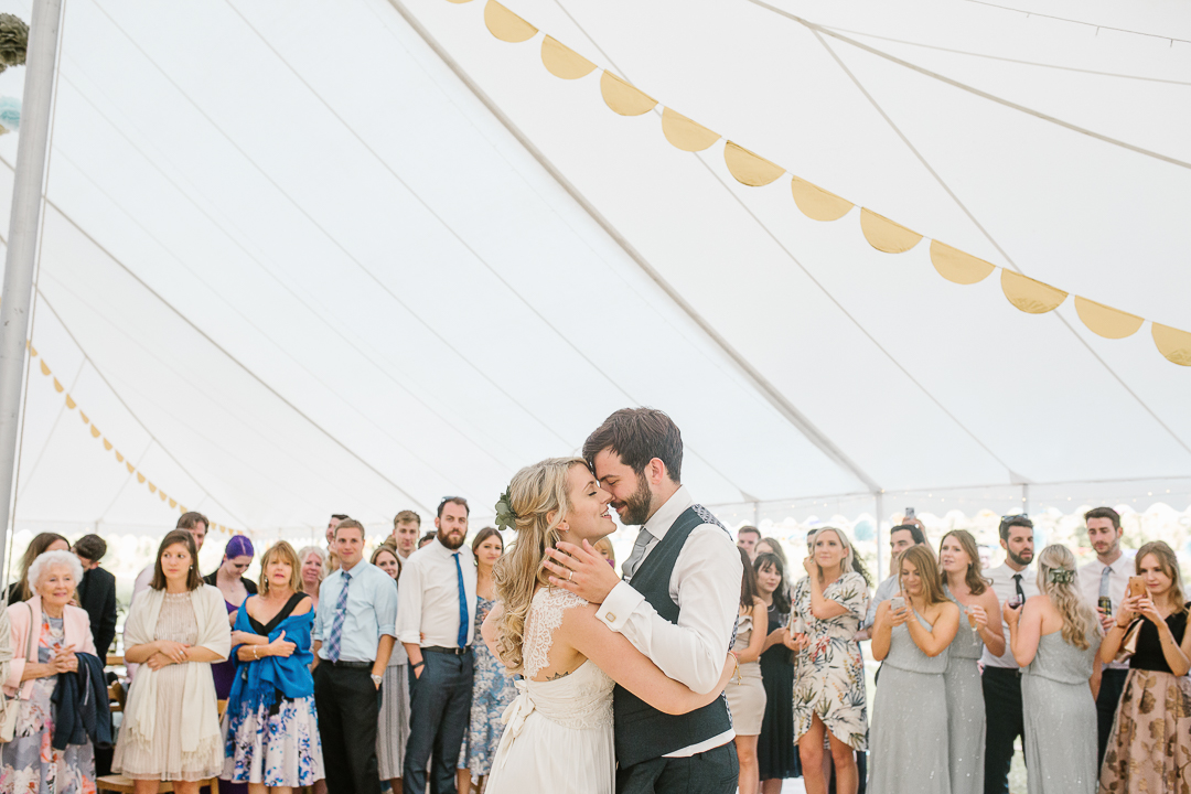 romantic photo of bride and groom kissing during their first dance