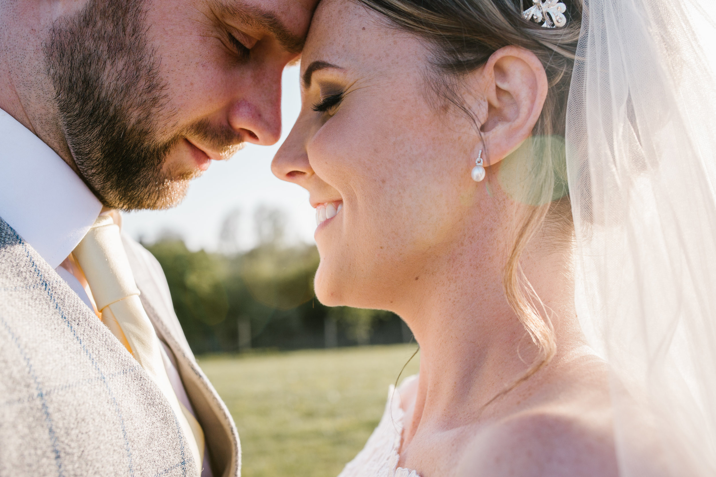 Natural close up photo of bride and groom at golden hour at the boat house aston marina in staffordshire