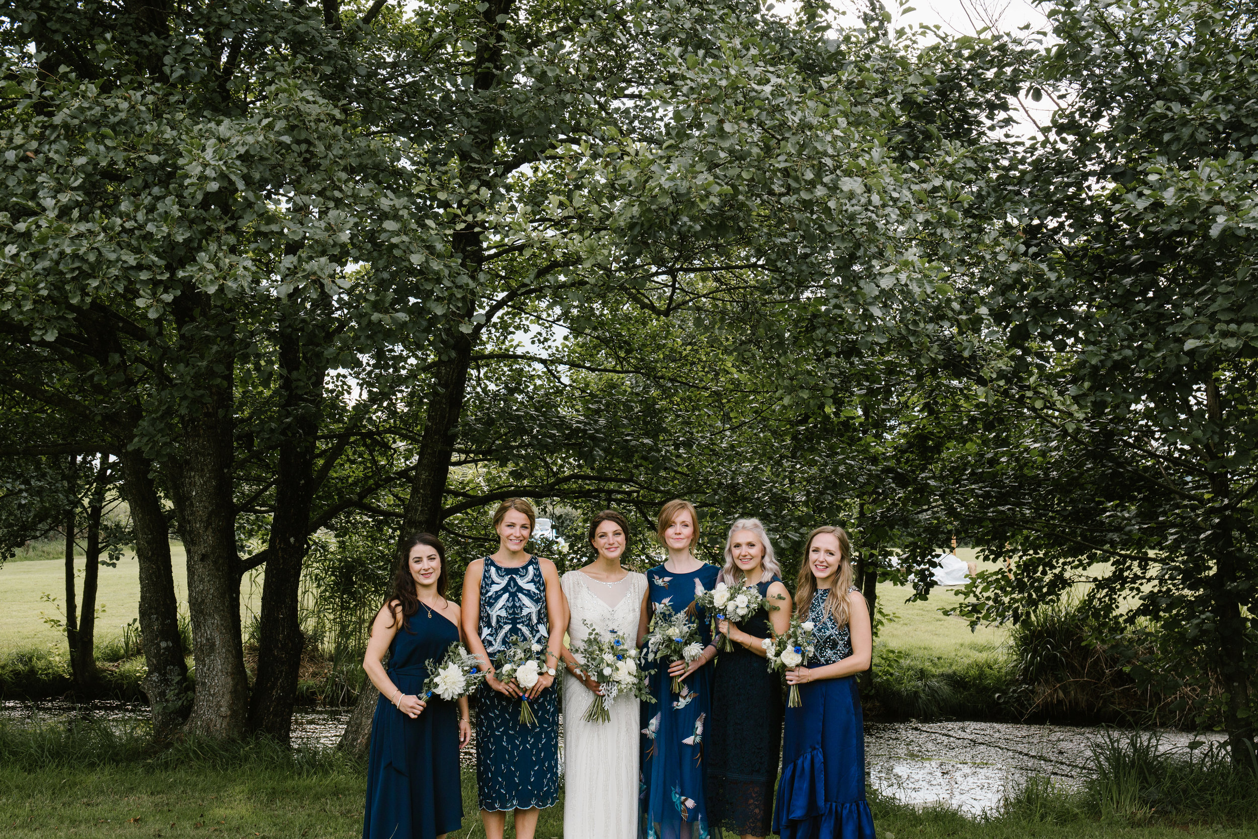 bridesmaids in different kind of dresses
