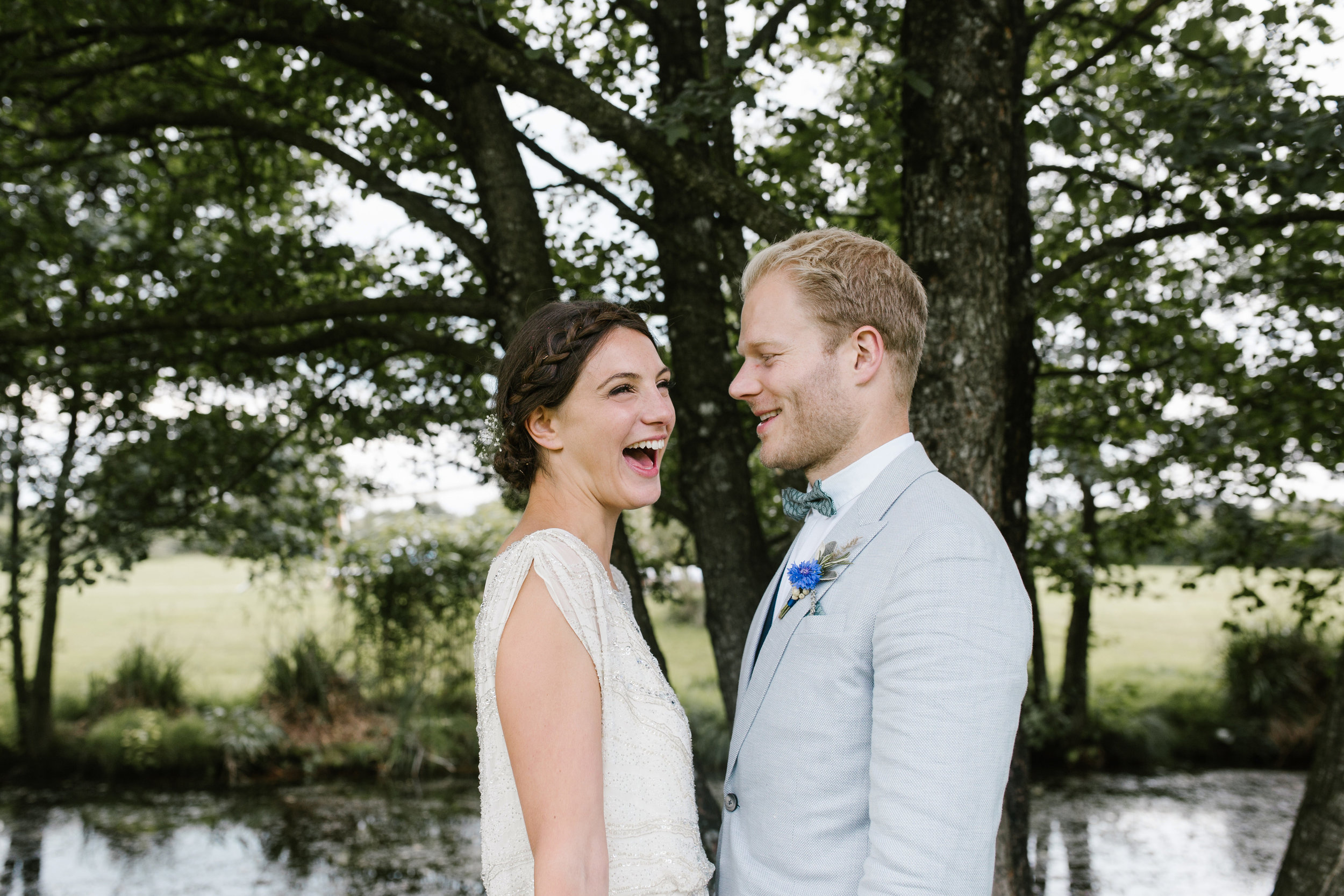 happy photo of boho bride laughing at her husband
