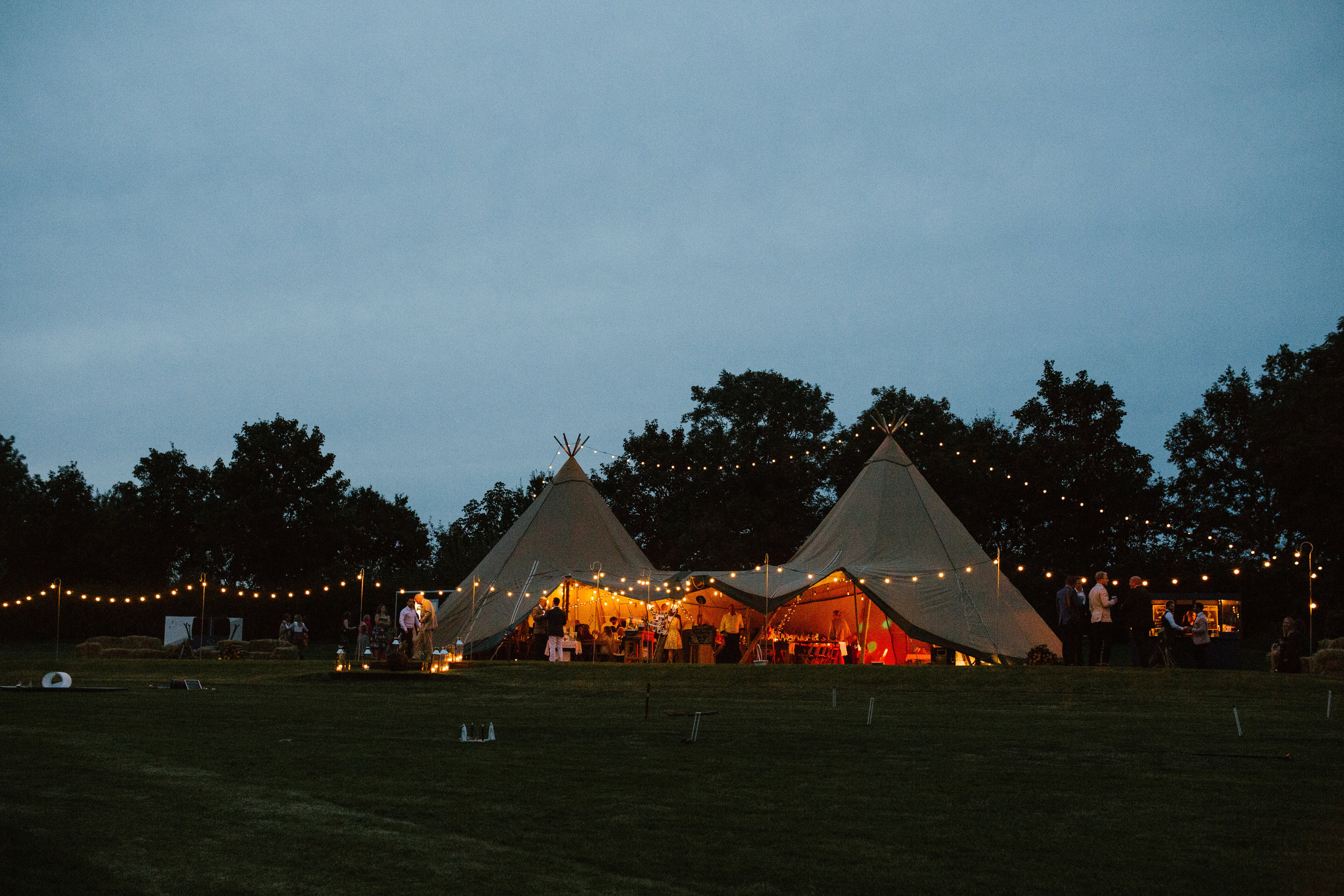 shot of the tipi at night time with the festoon lights creating an atmosphere