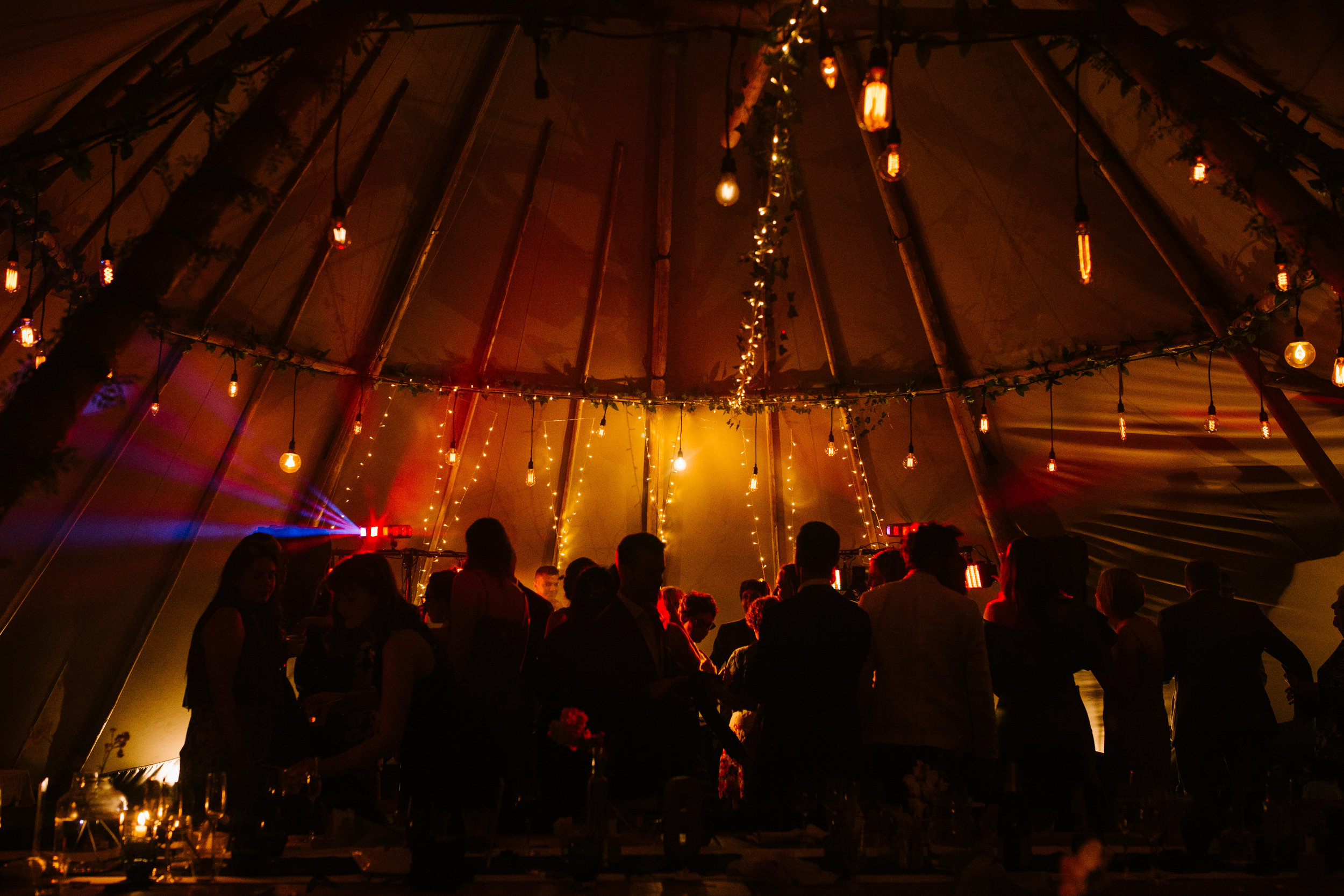 atmospheric shot of the tipi and the dance floor at night time