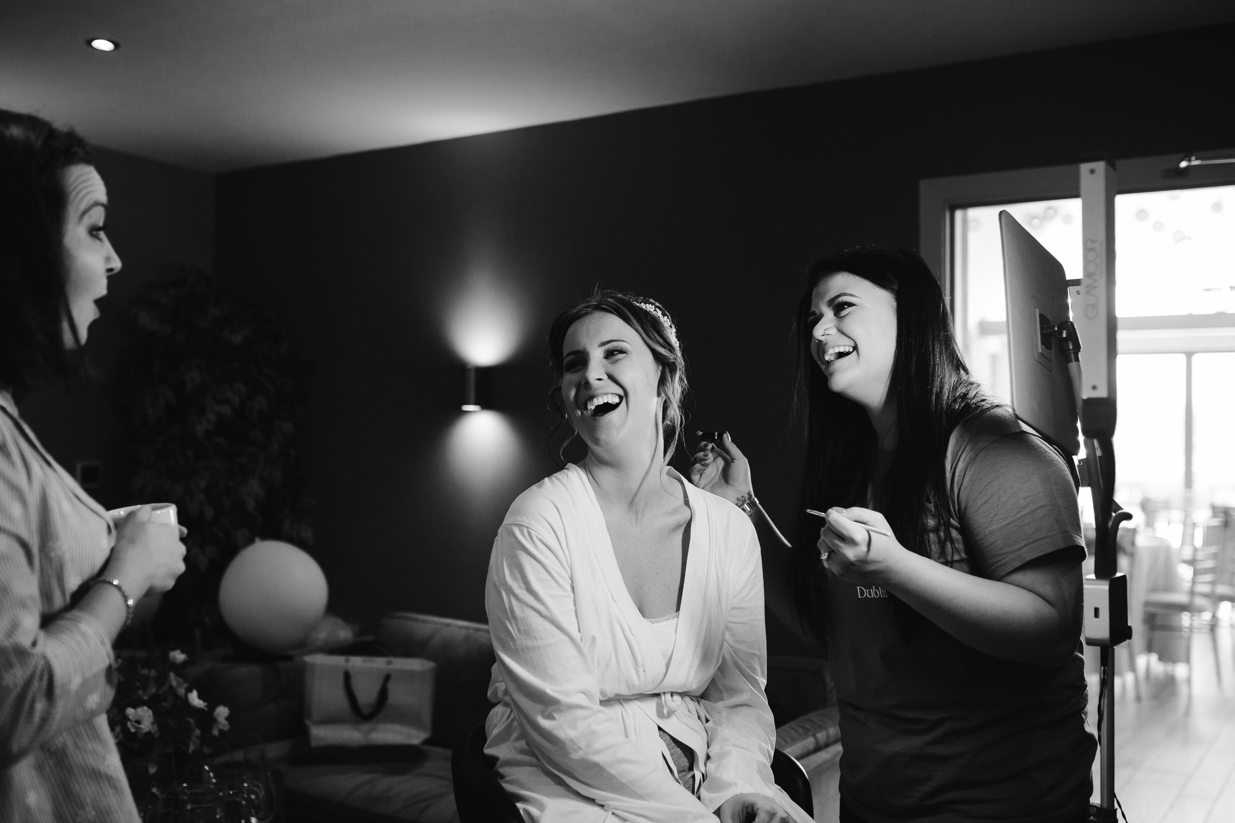 natural photo of bride laughing on the morning of her wedding day
