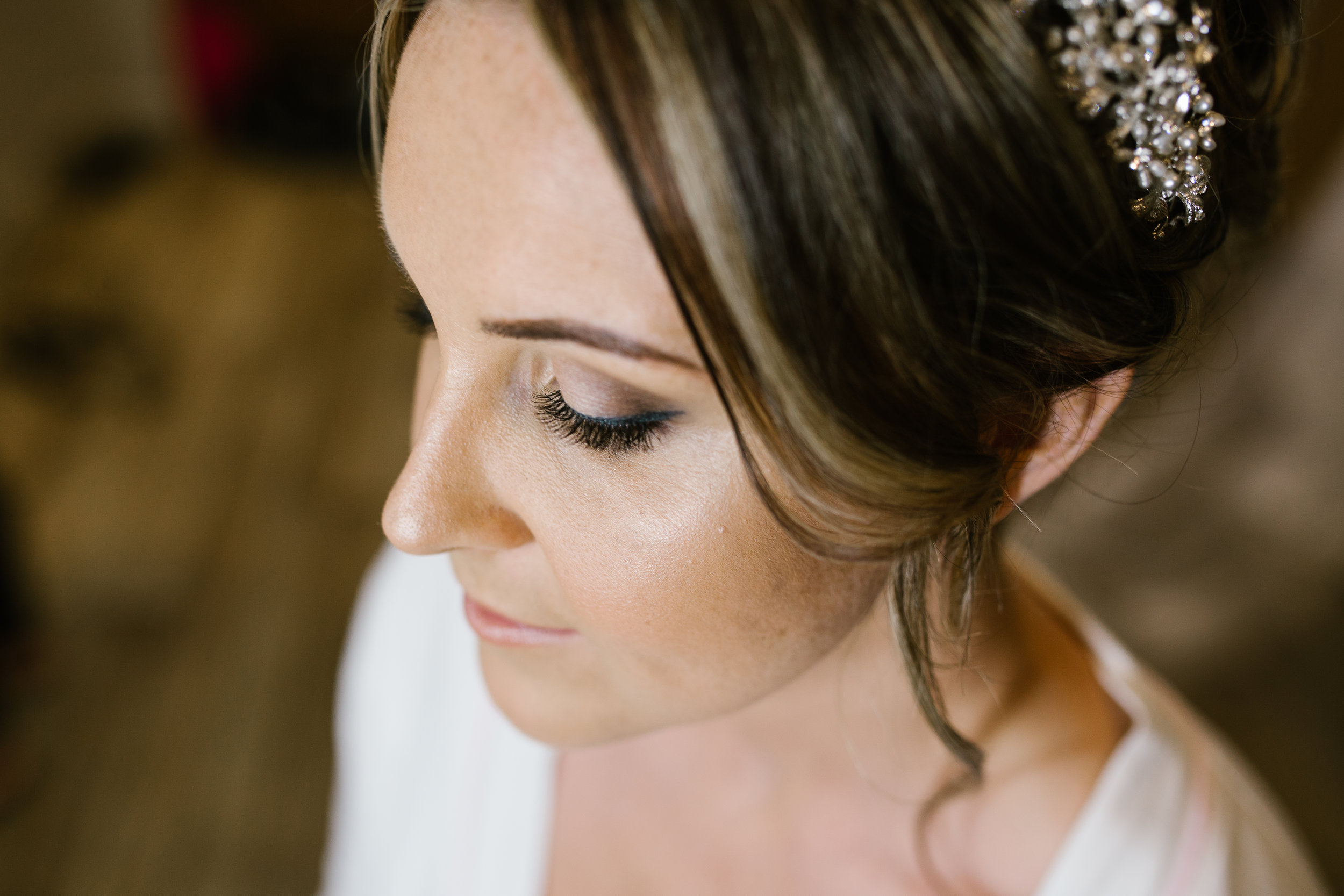 close up photograph of bride on the morning of her wedding day