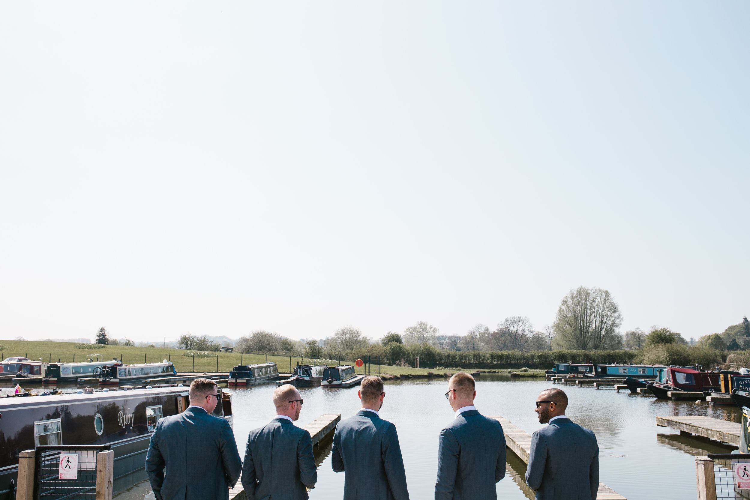 groomsmen enjoying the view at aston marina wedding venue