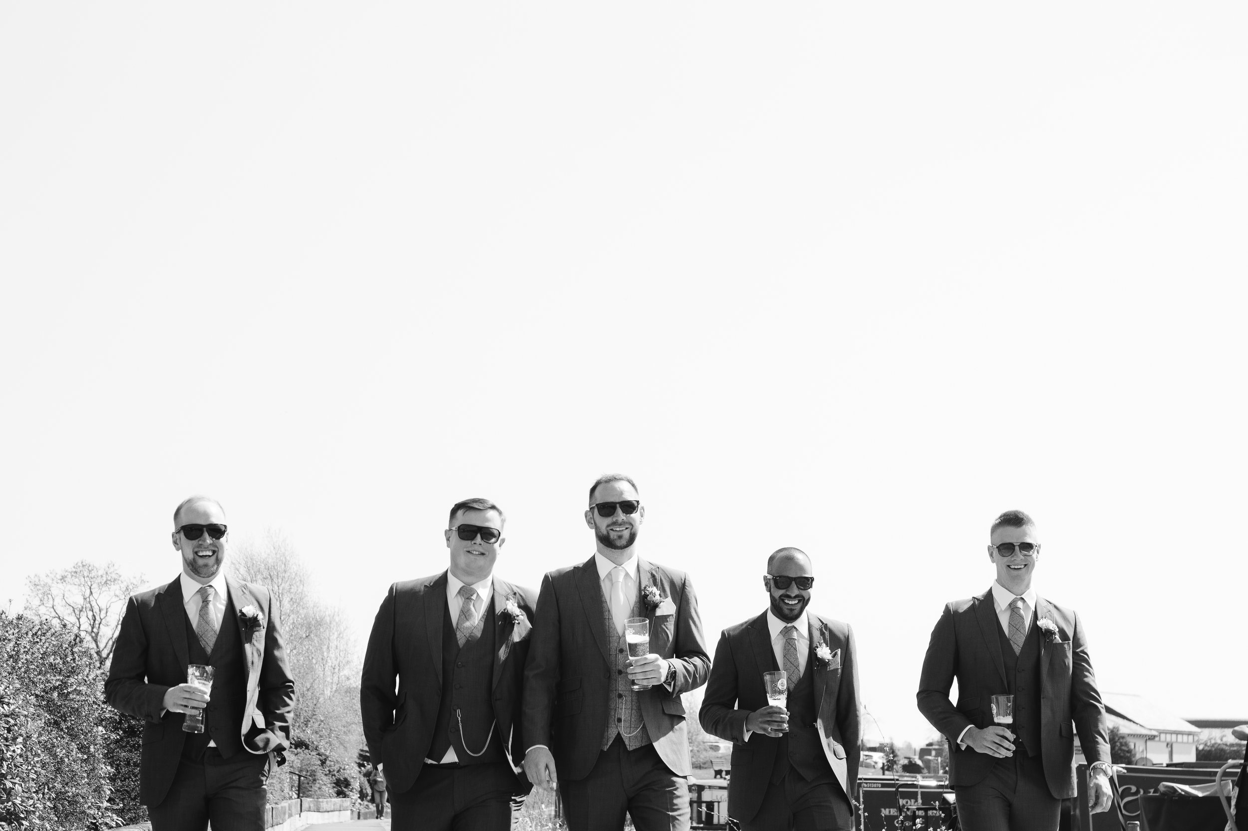 natural black and white photograph of groomsmen at the boat house wedding venue in staffordshire
