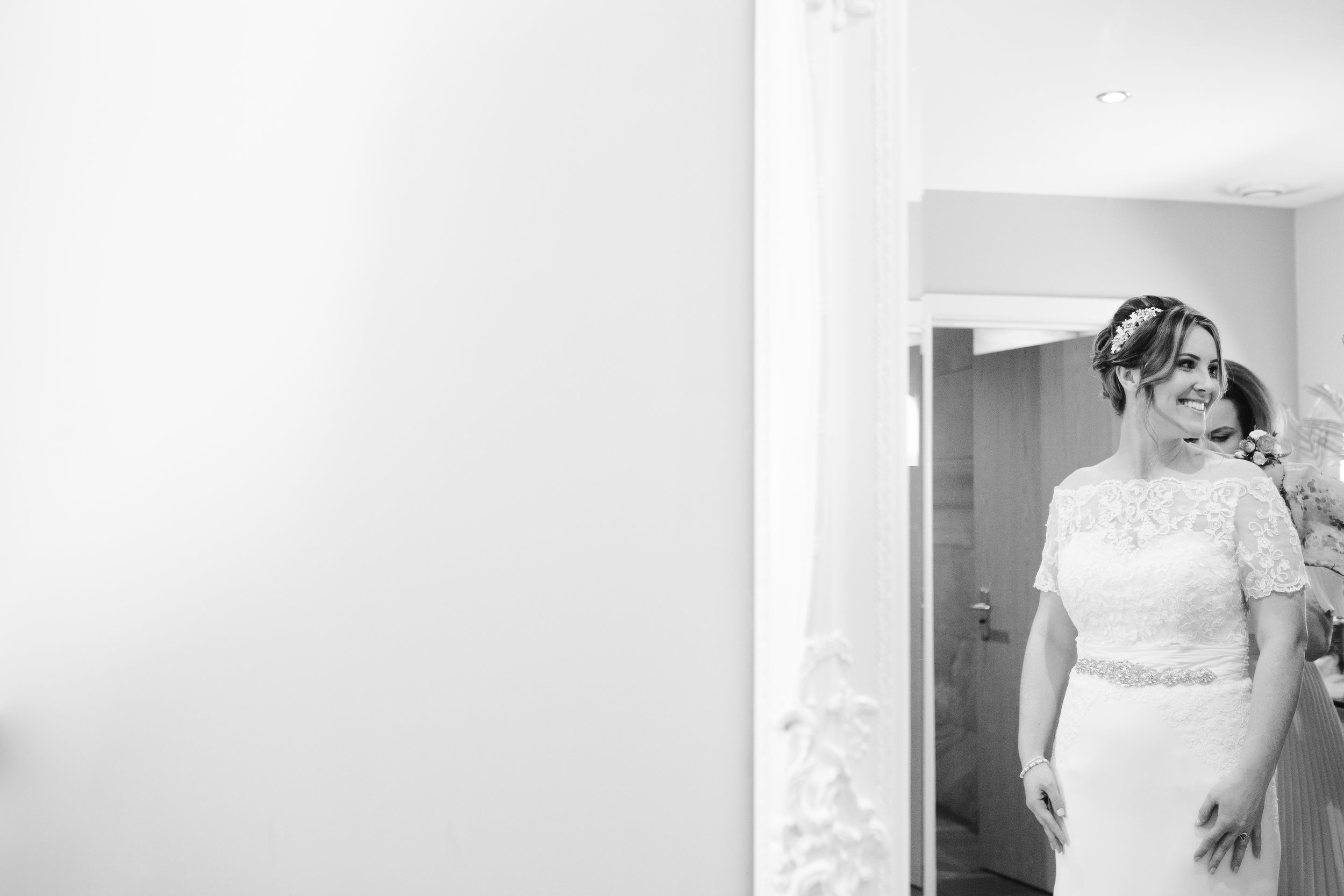 black and white photo of bride before she walks down the aisle