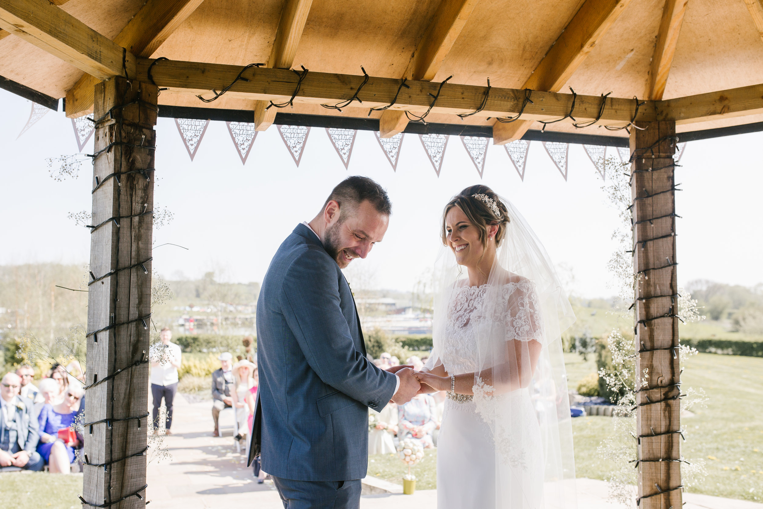 bride and groom crying together at their outdoor wedding ceremony in staffordshire