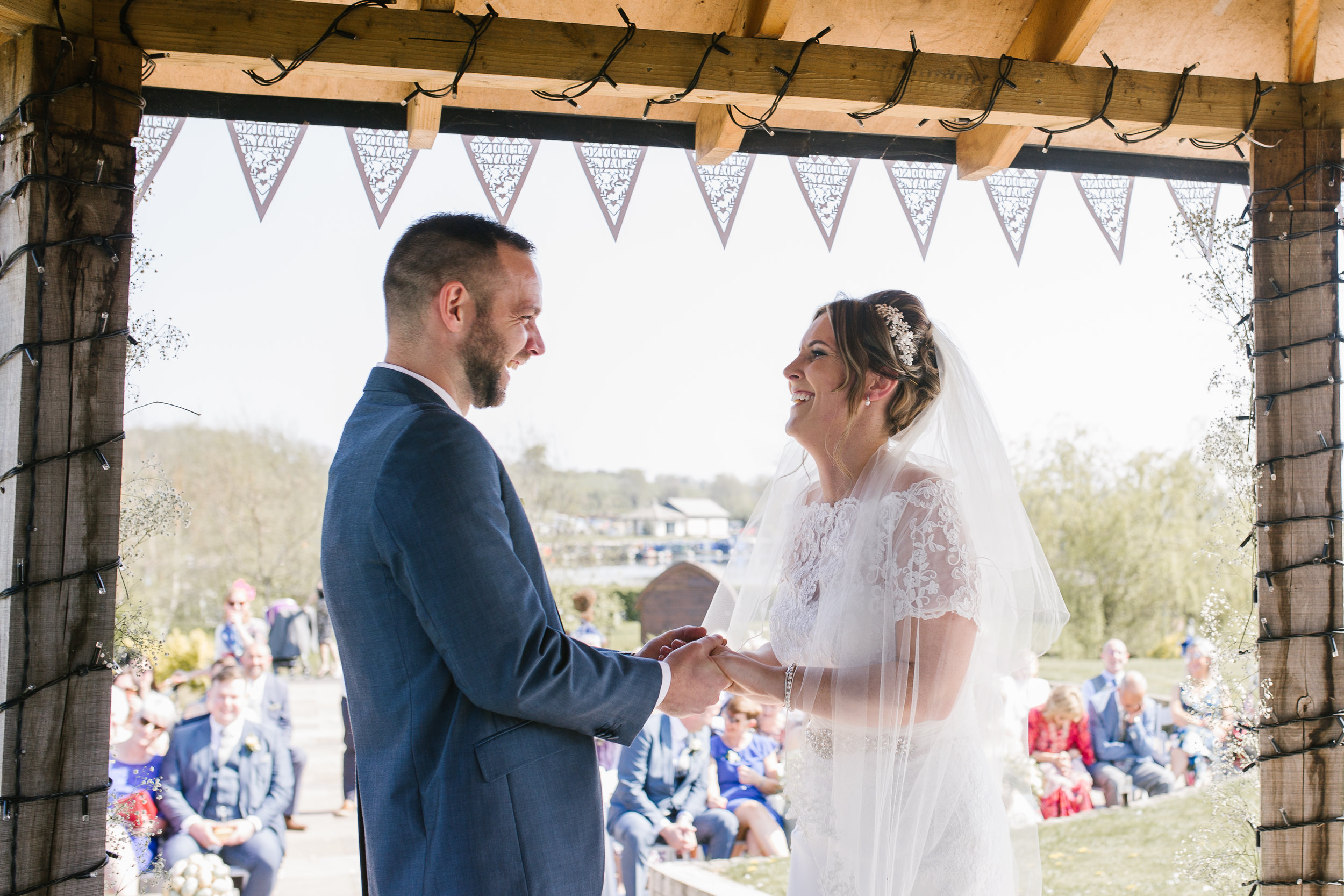 bride and groom becoming husband and wife at their outdoor summer ceremony