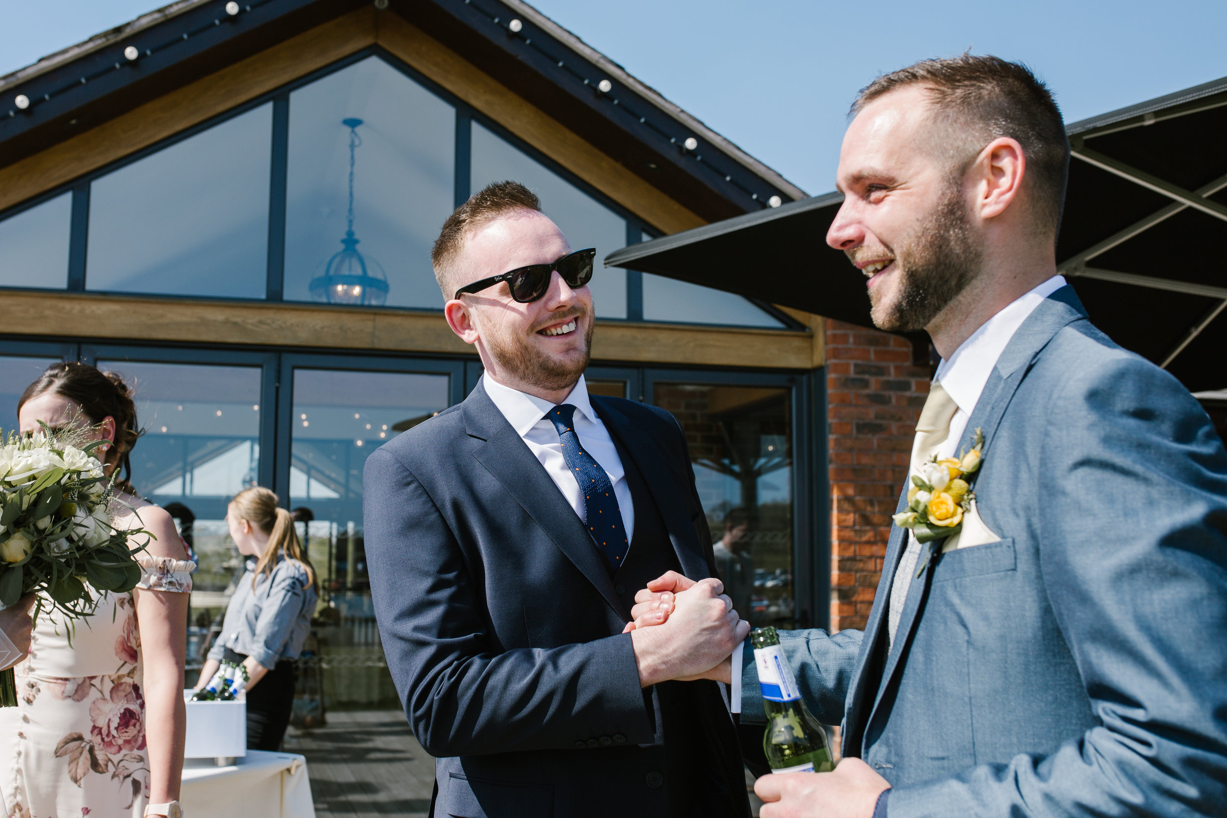 groom greeted by his guests at aston marina