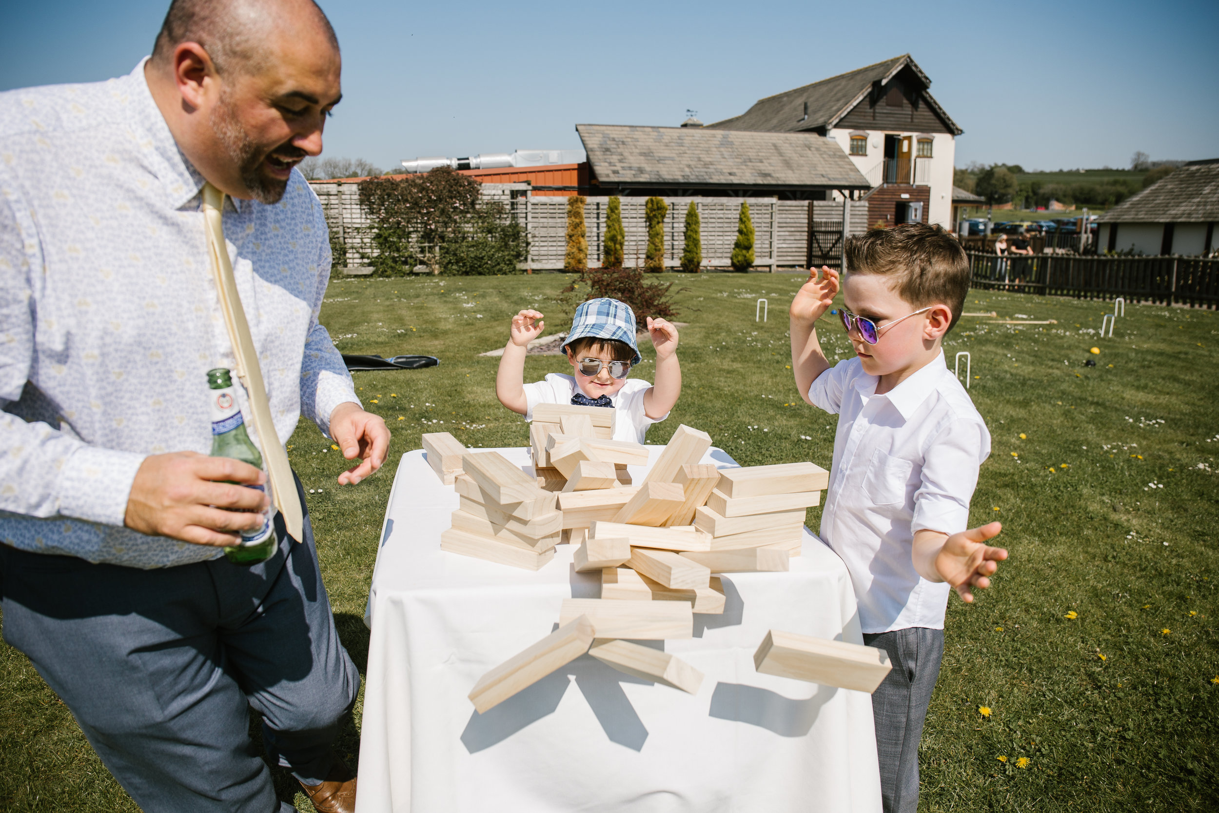 kids at weddings playing jenga together at aston marina in staffordshire