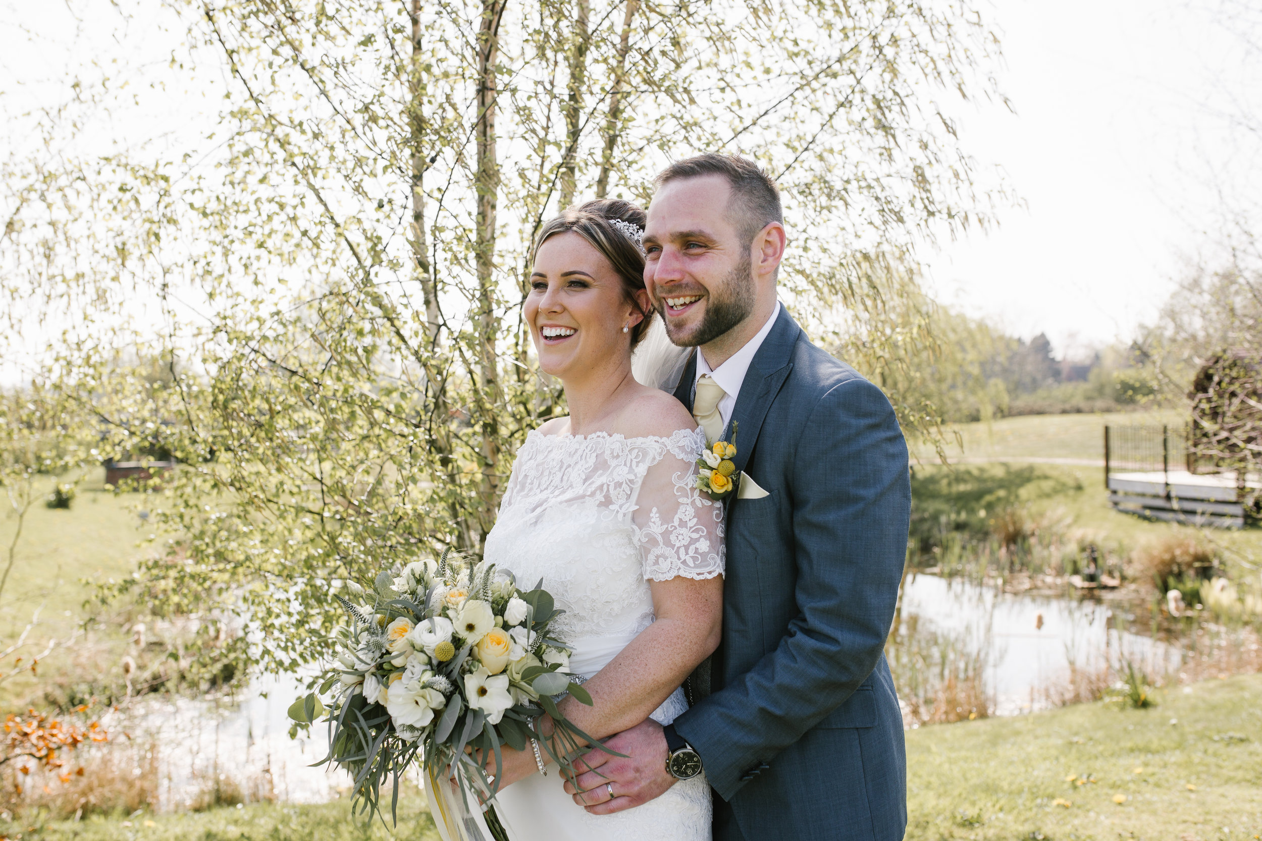 natural photo of newlyweds in aston marina boat house