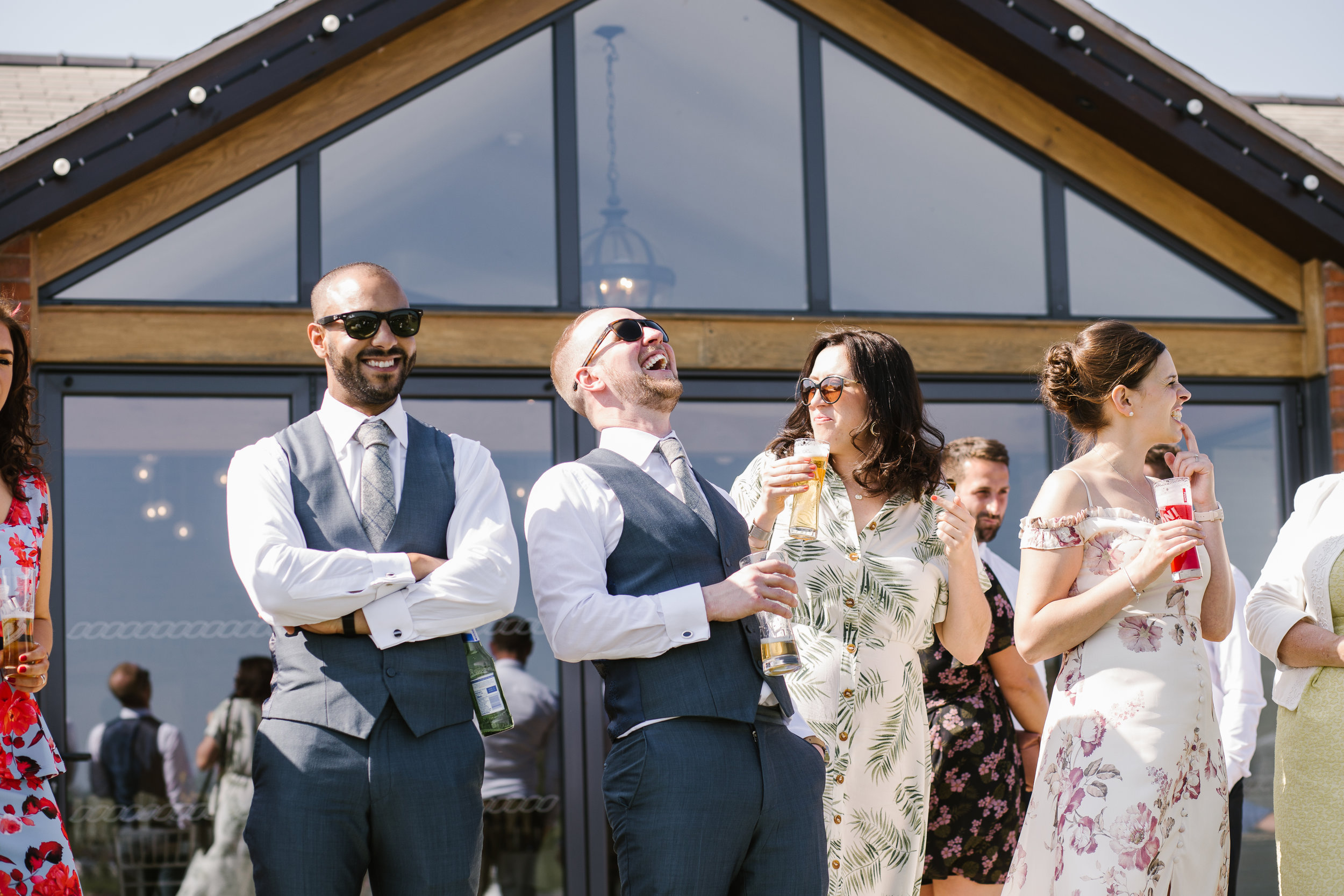wedding guests laughing at outdoor wedding at aston marina
