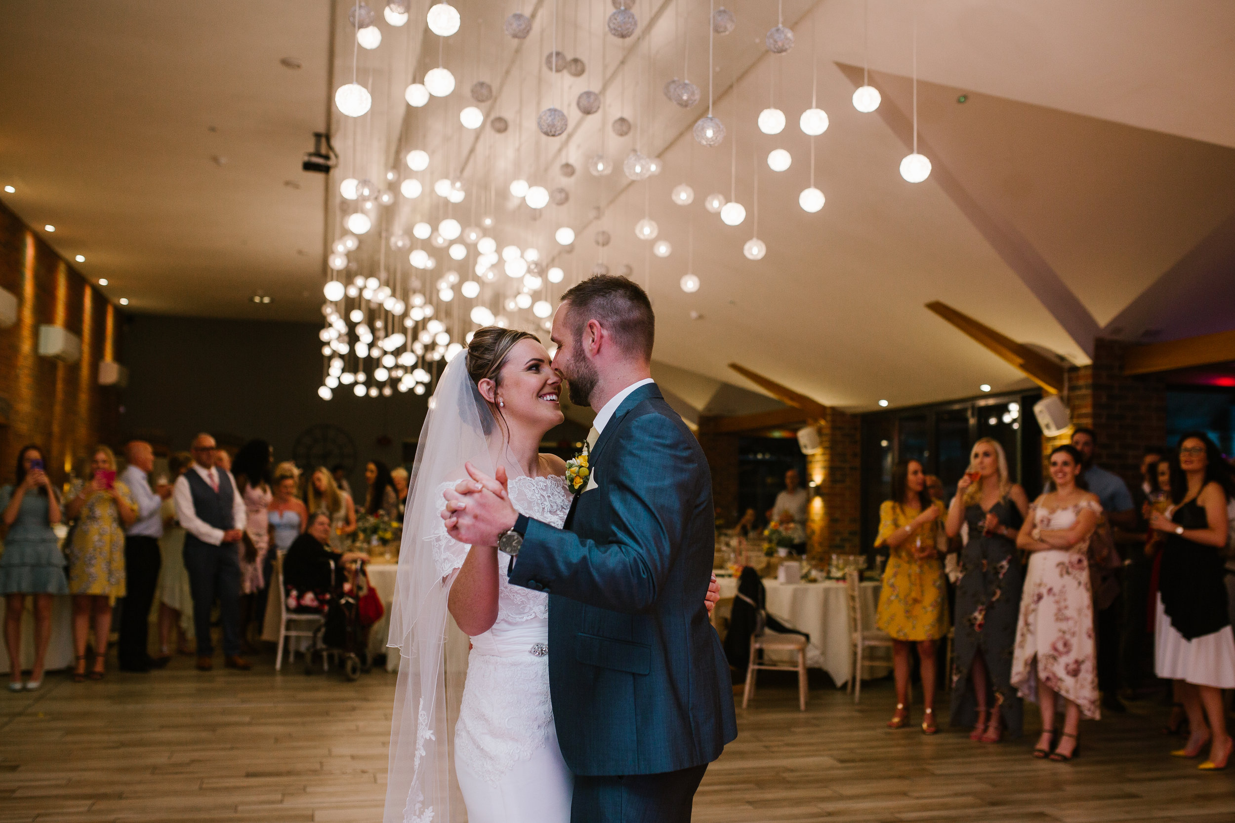 bride and groom dancing together for their first dance to Tom Walker You and I