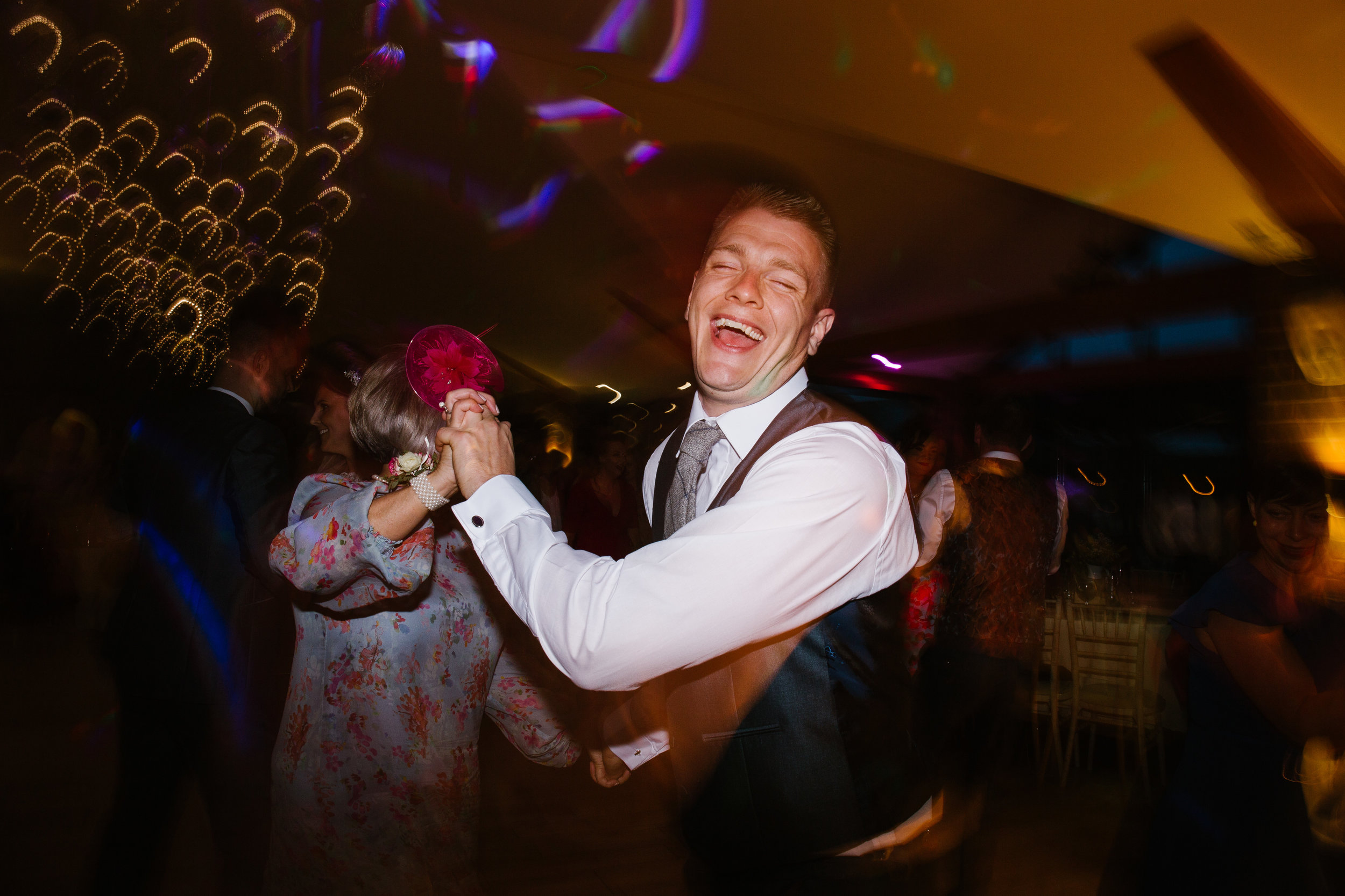 best man dancing on the evening of an awesome wedding
