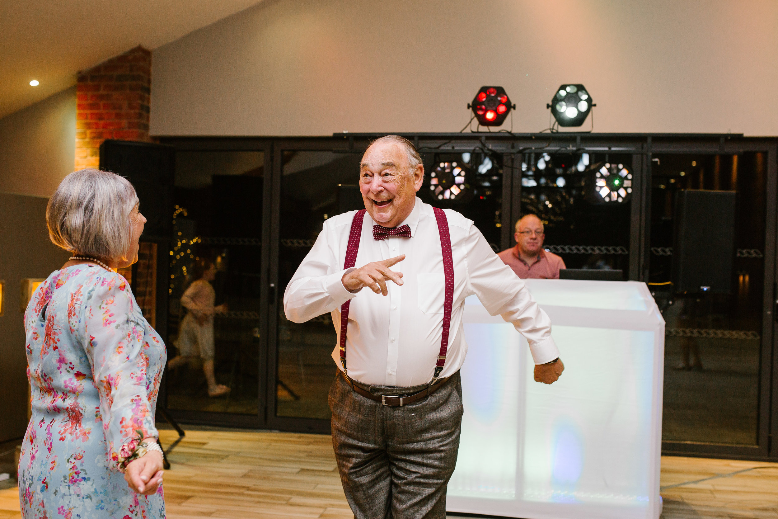 grandad dancing on the dance floor with a huge smile on his face