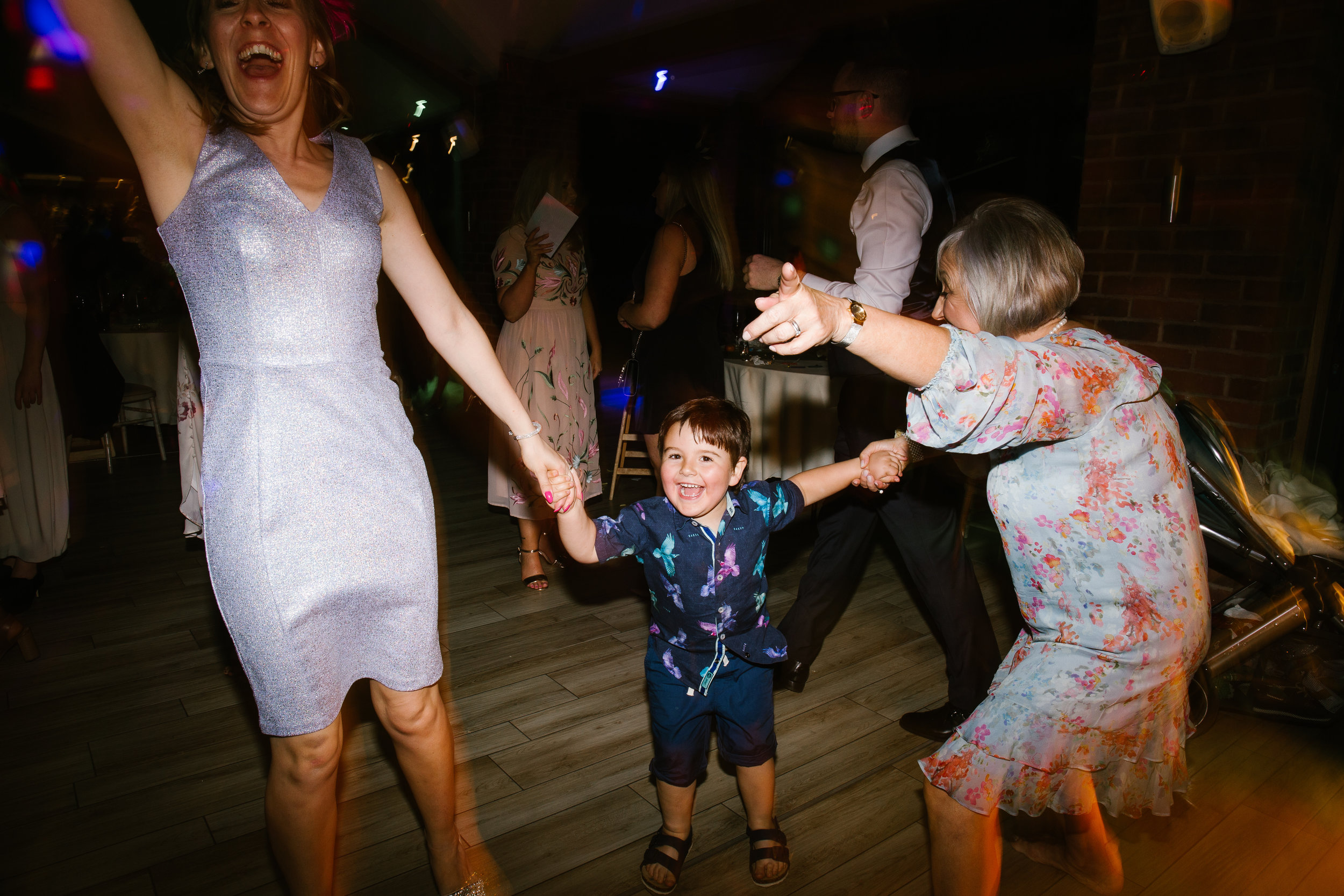 little boy jumping up and down on the dance floor at the party music