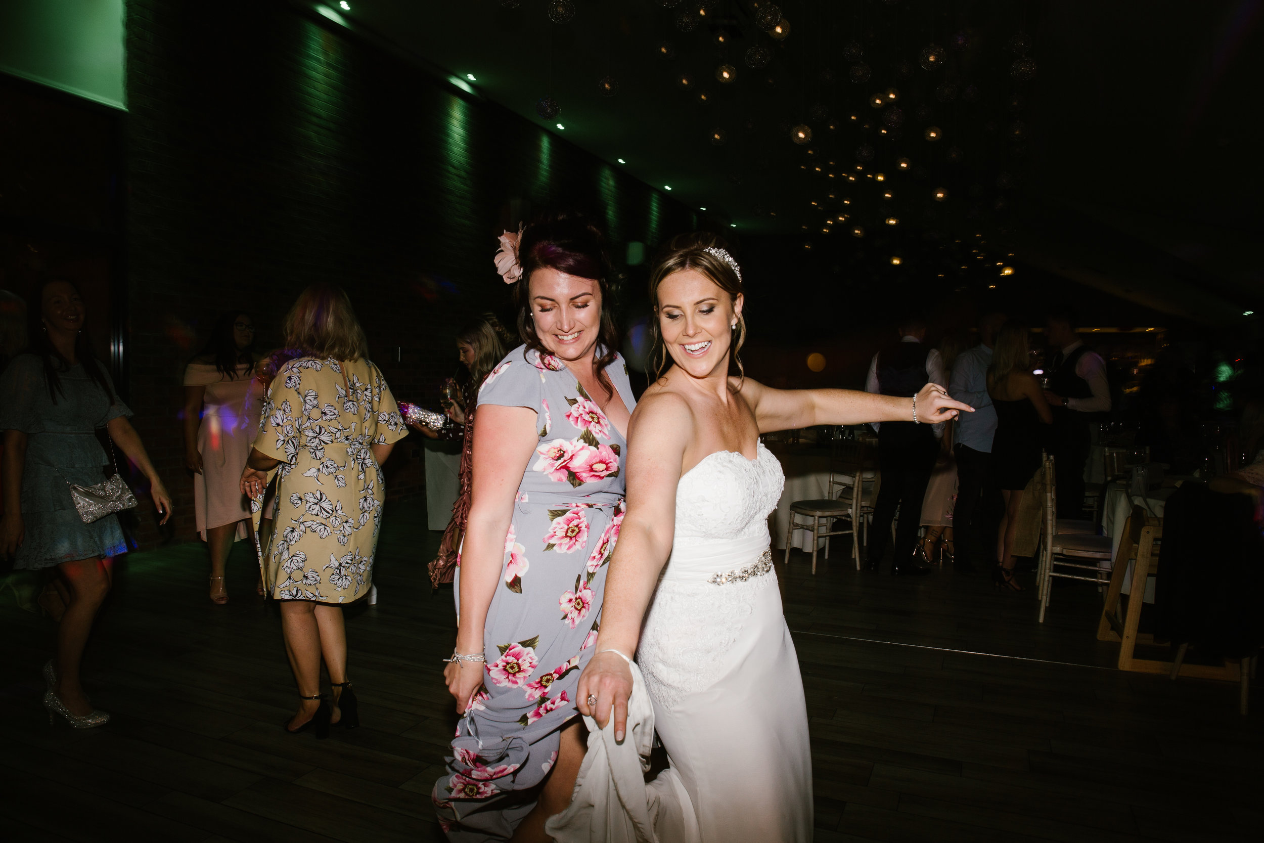 wedding guest dancing with the bride at the wedding party at the boat house in staffordshire