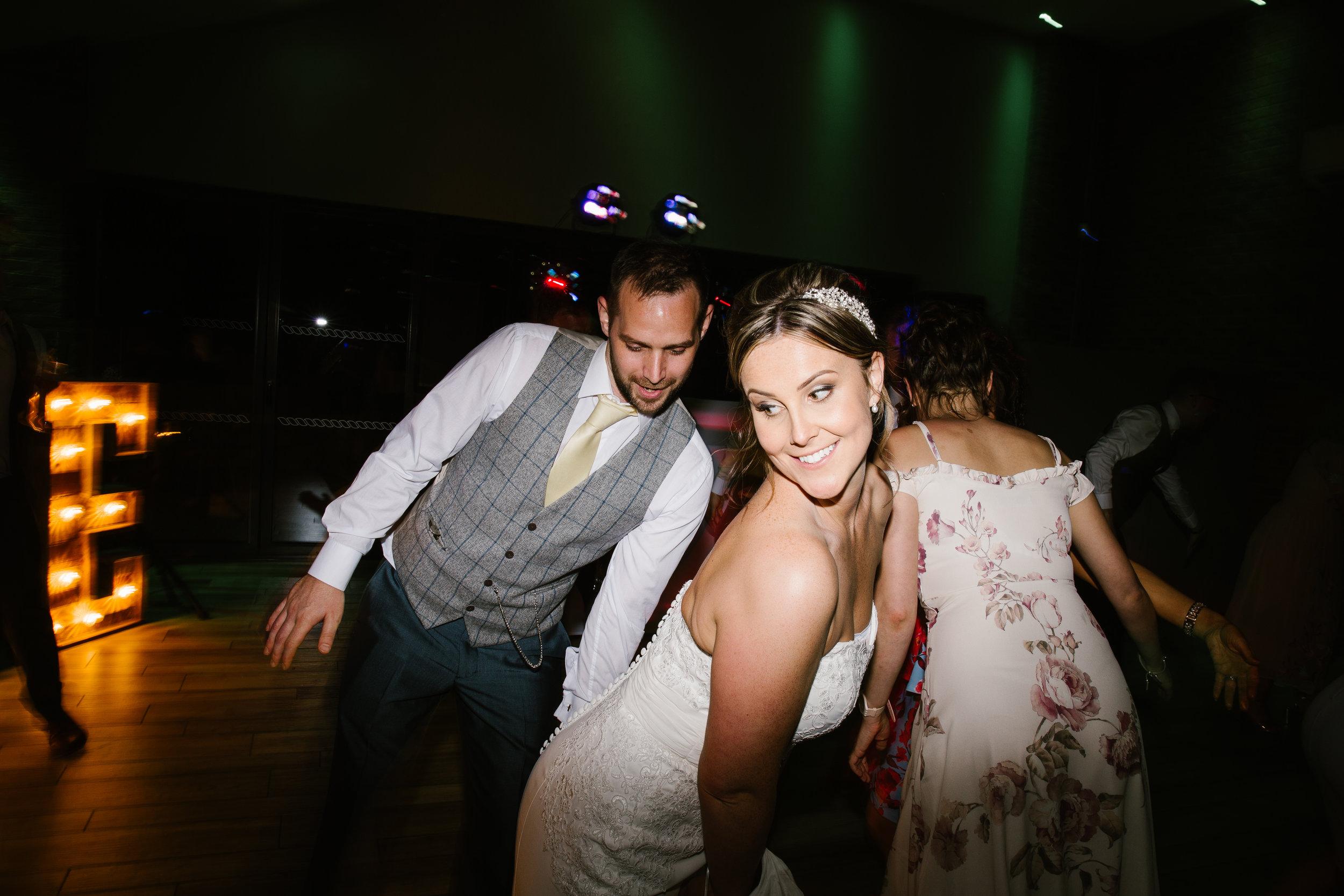 bride and groom being seductive on the dance floor