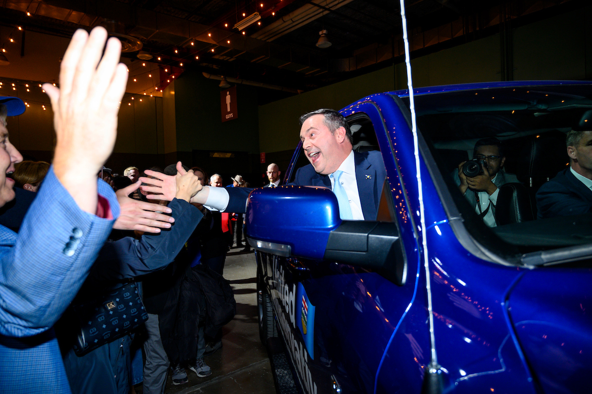 UCP leader and Alberta Premier designate Jason Kenney celebrates with supporters as he is driven in.