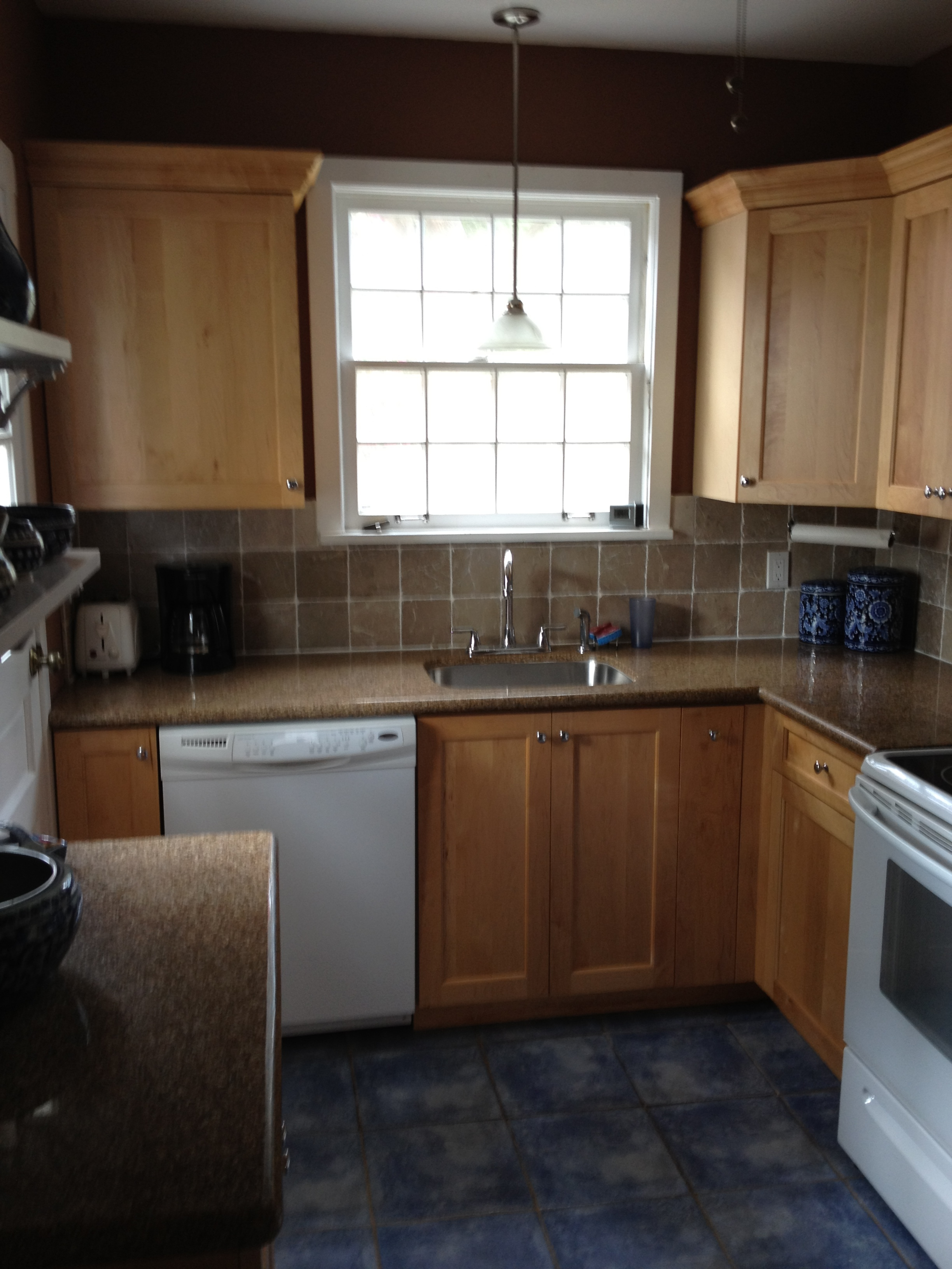 Kitchen: Before. Blue tile, brown speckled countertops, tan backsplash, natural wood cabinets, white appliances, brown walls....this room needed some love!