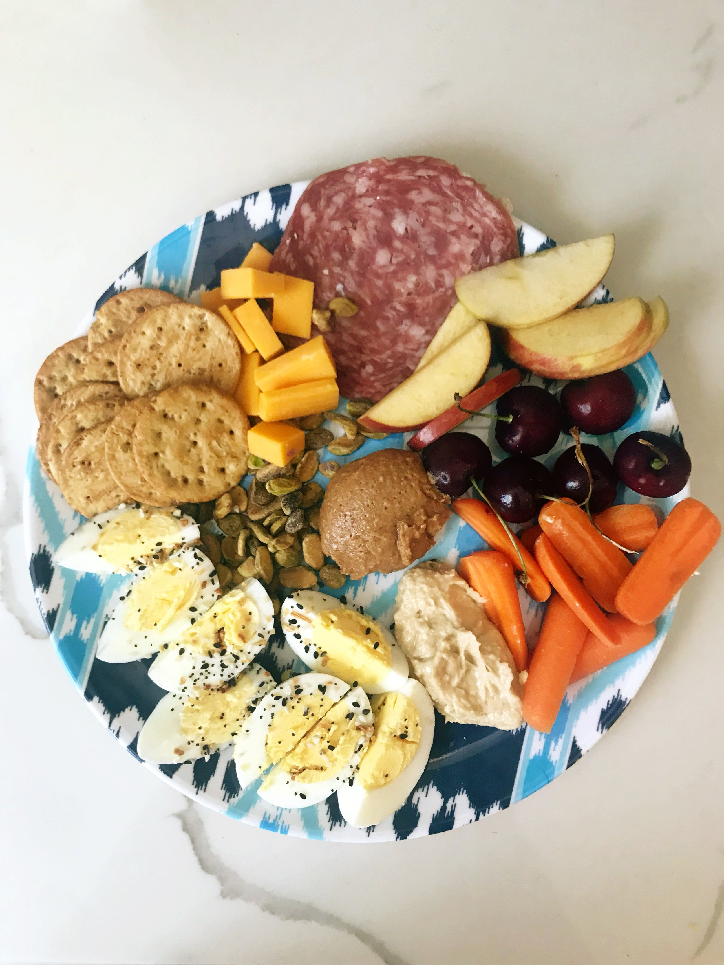 This is a typical lunch plate for me. My kids eat most of these things too so its nice to not have to make two different lunches for myself and them .