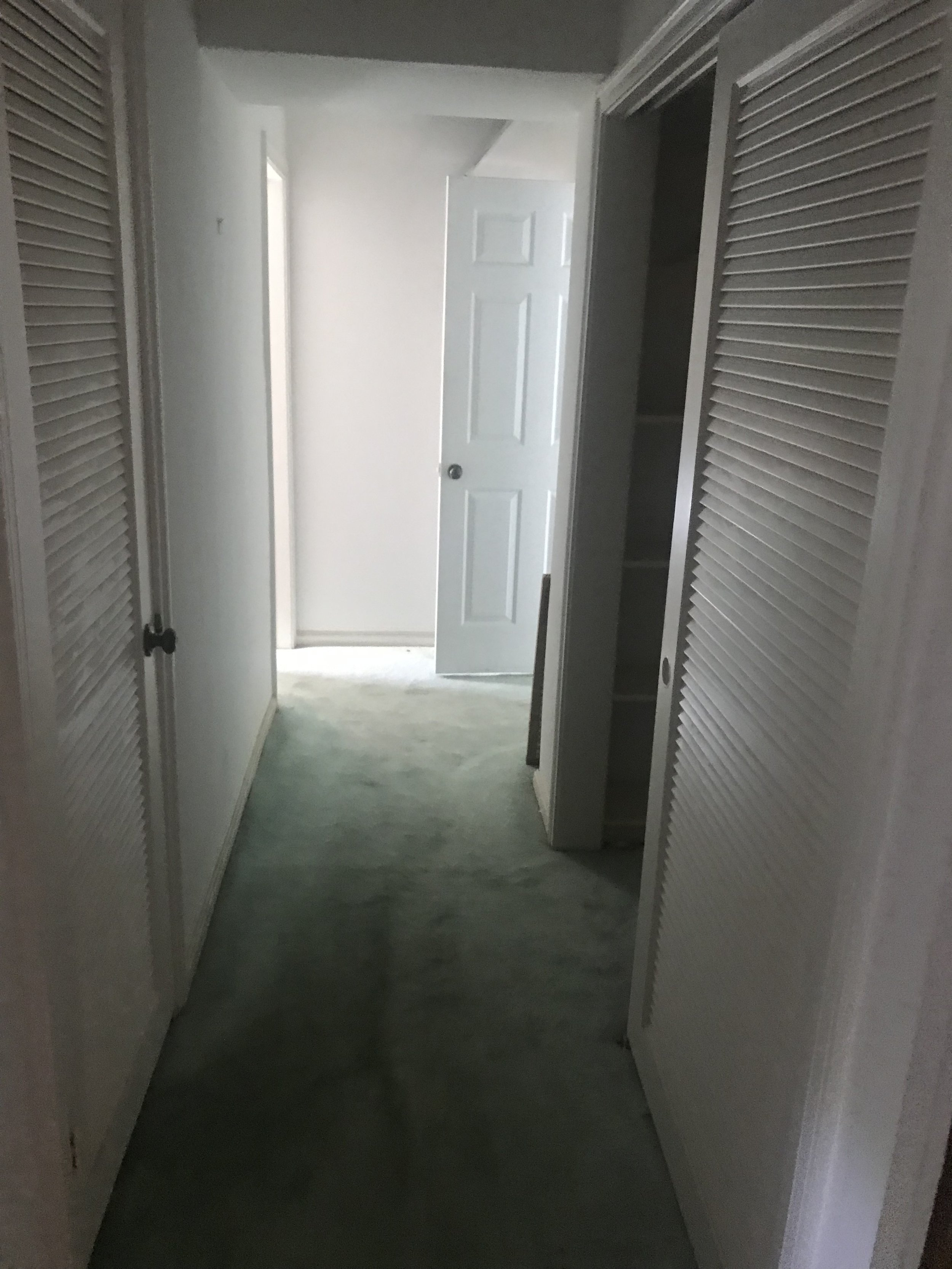 Hallway leading to the bath/closet area. This whole area is being ripped out and reworked to allow for a larger bedroom, closet and master bath.
